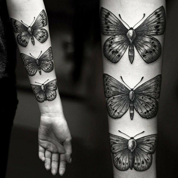 a9c81030318c3 Moth-like designs. And also cool and sleek. Every single butterfly in the  arms makes a great butterfly tattoo for men.